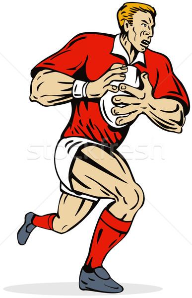 Red uniform rugby player running Stock photo © patrimonio