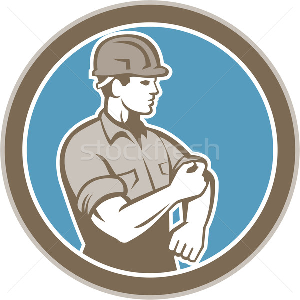 Construction Worker Rolling Up Sleeve Circle Retro Stock photo © patrimonio