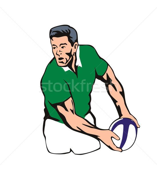 Stock photo: Irish Rugby player passing ball