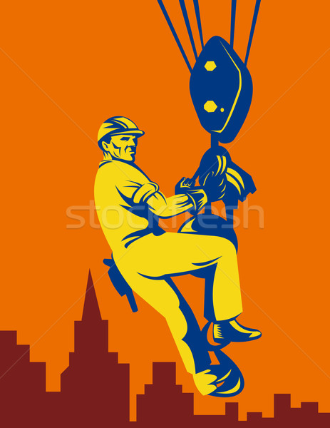 Construction worker being hoisted with buildings Stock photo © patrimonio