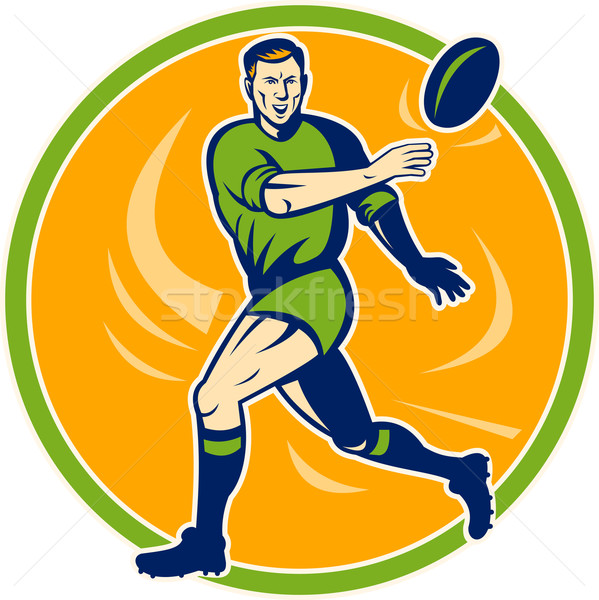 Rugby player running and passing ball Stock photo © patrimonio