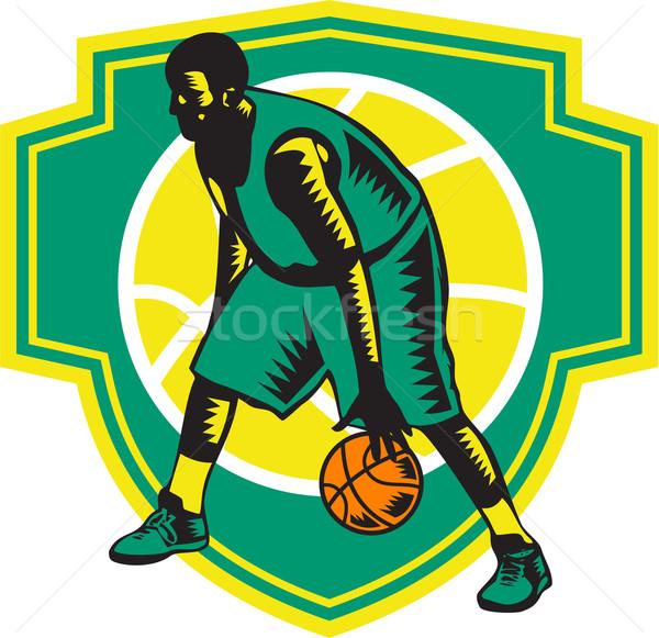 Basketball Player Dribbling Ball Woodcut Shield Retro Stock photo © patrimonio
