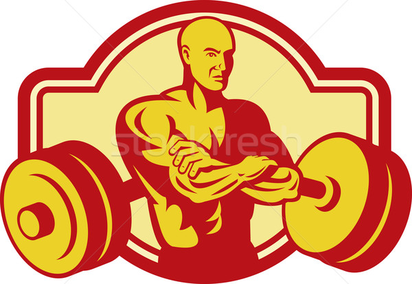 Weightlifter or Body builder posing with weights Stock photo © patrimonio