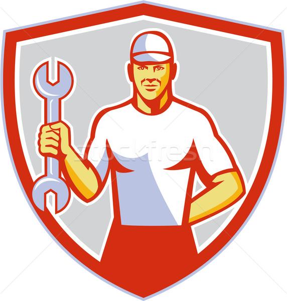 Szerelő tart franciakulcs címer retro illusztráció Stock fotó © patrimonio