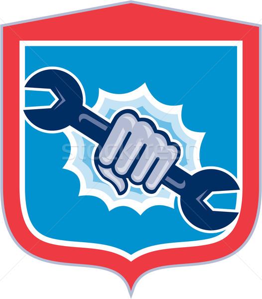 Mechanic Hand Holding Spanner Shield Punching  Stock photo © patrimonio