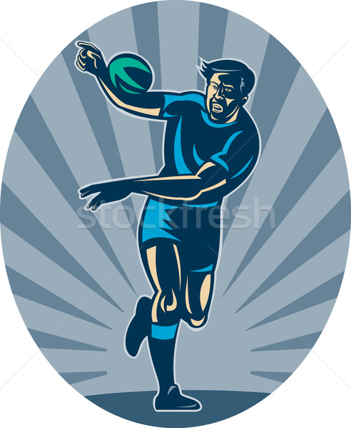 Rugby player running with ball and passing Stock photo © patrimonio