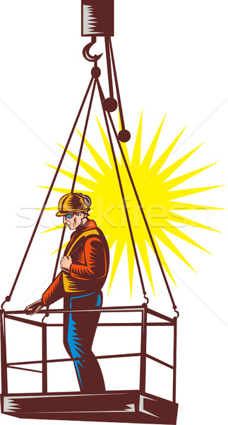 Construction worker on platform being hoisted up Stock photo © patrimonio