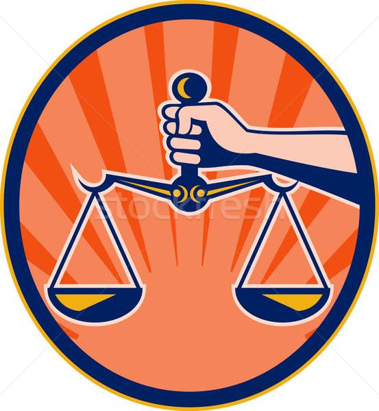 Hand holding scales of justice Stock photo © patrimonio