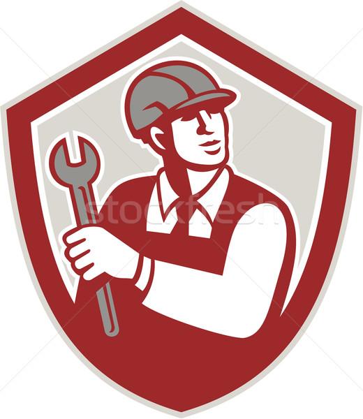 Szerelő tart franciakulcs pajzs címer retro Stock fotó © patrimonio