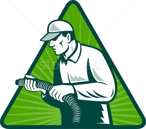 Stock photo: tradesman home insulation technician with hose