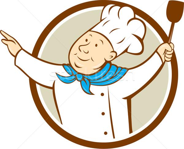 Chef cuoco braccia fuori spatola cerchio Foto d'archivio © patrimonio