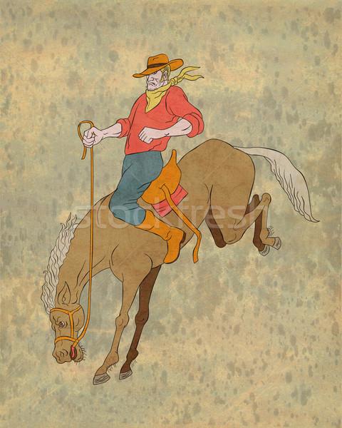 rodeo cowboy riding bucking horse bronco Stock photo © patrimonio