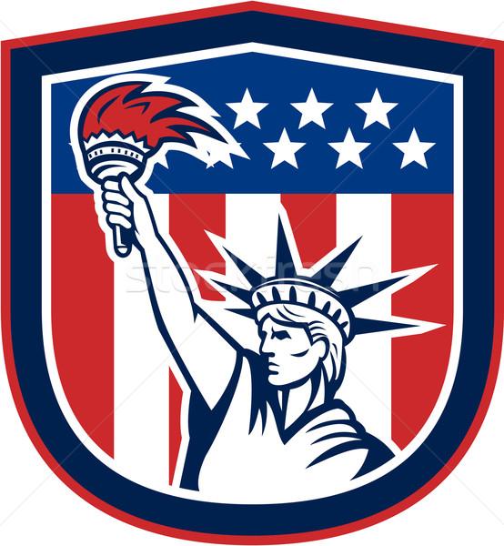 Statue of Liberty Holding FlamingTorch Shield  Stock photo © patrimonio