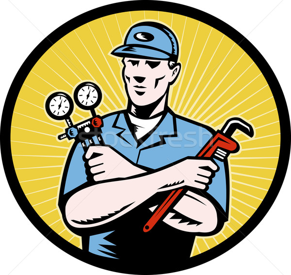 repairman serviceman holding ac manifold gauge wrench Stock photo © patrimonio