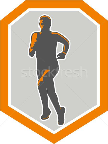 Maratón corredor ejecutando frente escudo retro Foto stock © patrimonio