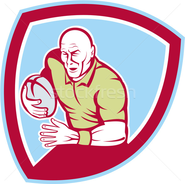 Rugby Player Running Charging Shield Cartoon Stock photo © patrimonio
