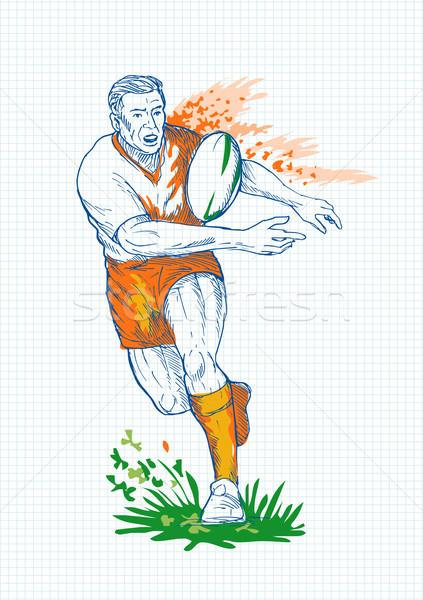 Rugby player running and passing ball Stock photo © patrimonio