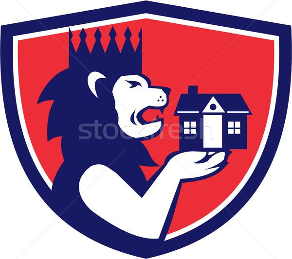 King Lion Holding House Crest Retro Stock photo © patrimonio