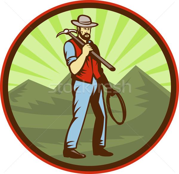 Miner carrying pick axe with mountains  Stock photo © patrimonio