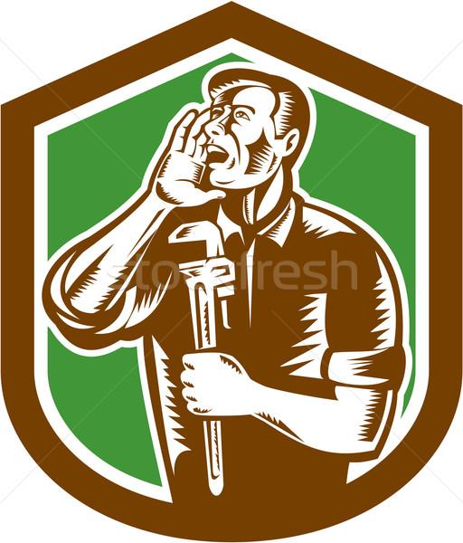Plumber Shouting Holding Wrench Woodcut Stock photo © patrimonio
