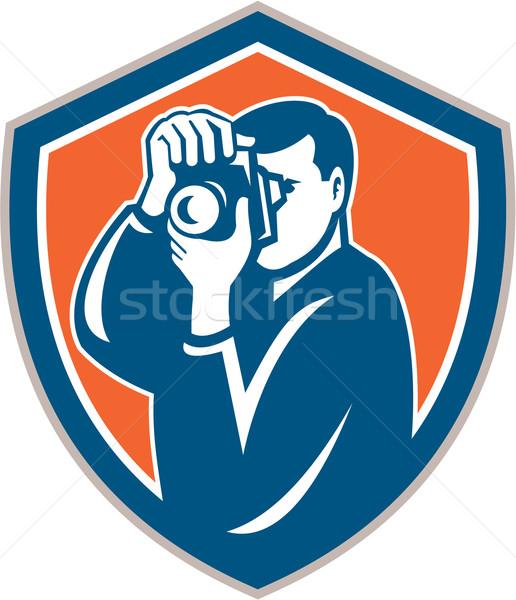 Stock photo: Photographer Aiming Camera Shield Retro