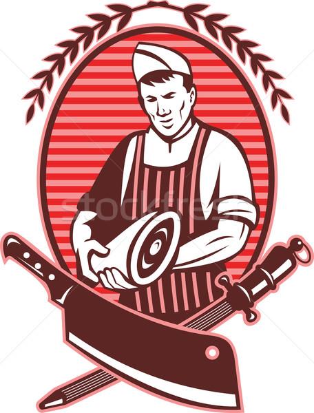Butcher holding meat knife sharpening tool Stock photo © patrimonio