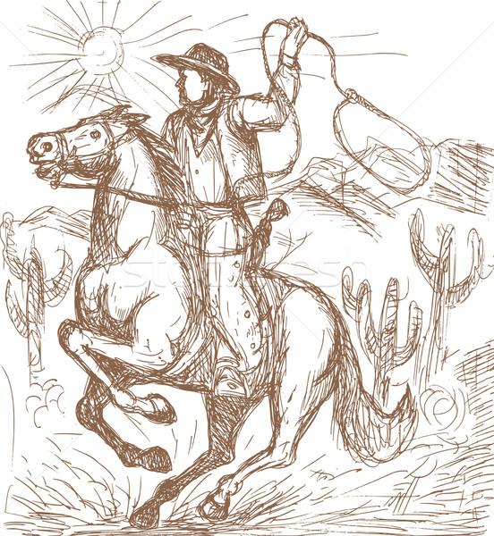 Cowboy with lasso riding a horse  Stock photo © patrimonio
