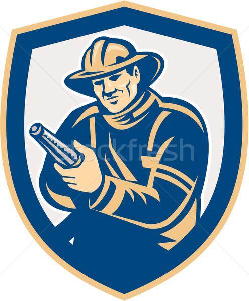 Fireman Firefighter Aiming Fire Hose Shield Retro Stock photo © patrimonio