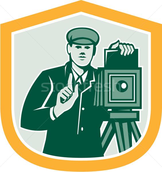 Stock photo: Photographer Shooting Vintage Camera Shield Retro