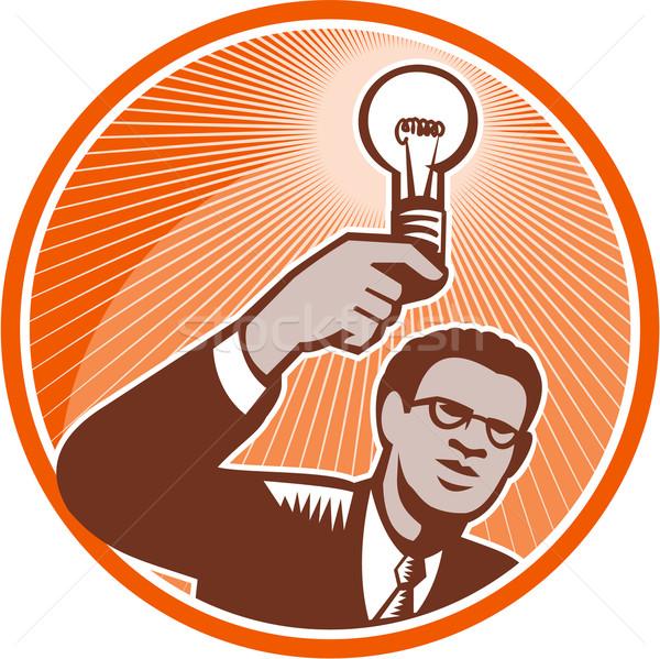 Businessman Holding Lightbulb Woodcut Stock photo © patrimonio
