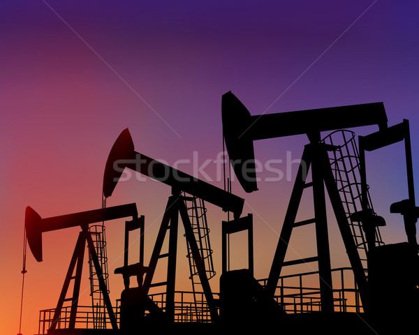Stock photo: Three oil wells in the desert at dusk