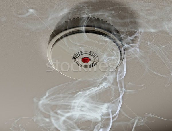 Smoke alarm in a smoky room Stock photo © paulfleet
