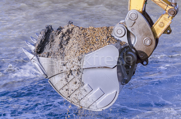 Dredging with an excavator Stock photo © paulfleet