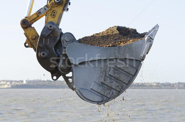 Excavator dredging a harbor Stock photo © paulfleet