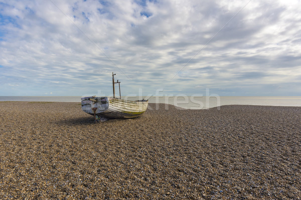 Fishing boat on the beach Stock photo © paulfleet