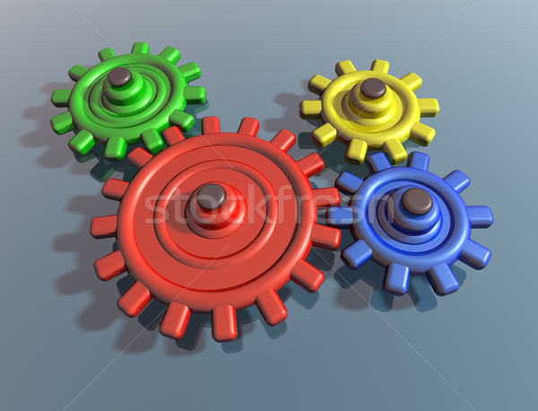 Brightly colored interlocking cogs Stock photo © paulfleet