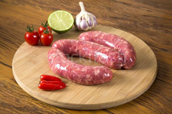 Kolbász nyers tábla zöldségek étel hús Stock fotó © paulovilela