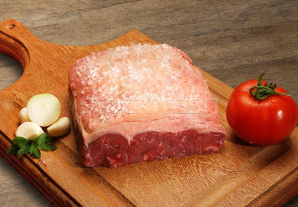 Nyers hús fából készült vágódeszka piac zöld Stock fotó © paulovilela