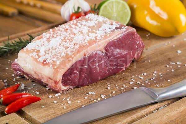 Nyers hús fából készült vágódeszka piac étel Stock fotó © paulovilela