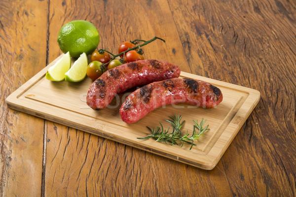 Carne alla griglia salsicce patate pomodori alla griglia grill Foto d'archivio © paulovilela