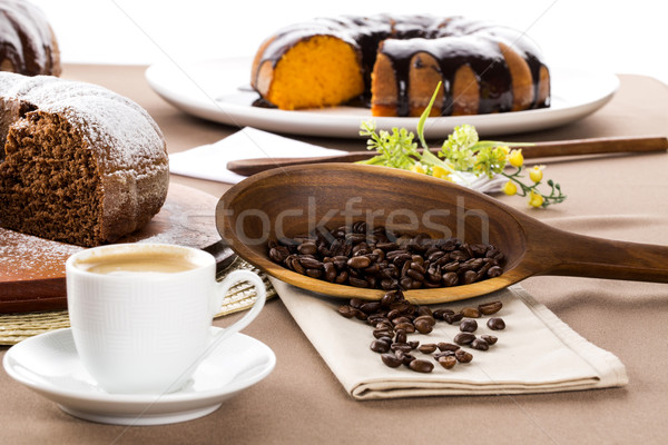 Chocolate cake on the table with cooffe in the background. Stock photo © paulovilela