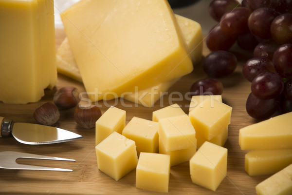 Queso parmesano tabla de cortar delicioso alimentos fondo azul Foto stock © paulovilela