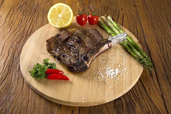 Carne alla griglia bianco piatto pomodori erba cipollina Foto d'archivio © paulovilela