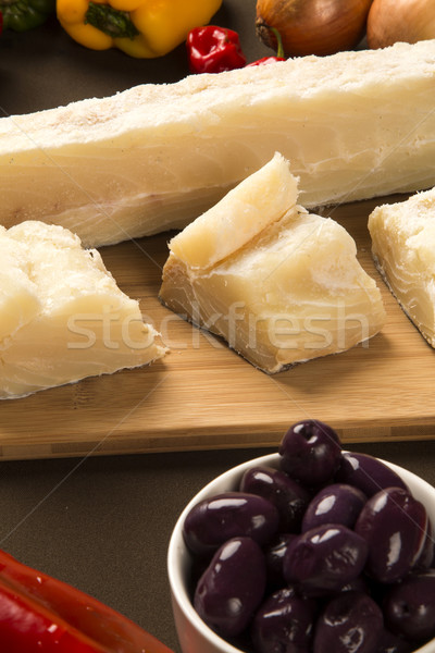 salted codfish on the wooden table with ingredients Stock photo © paulovilela