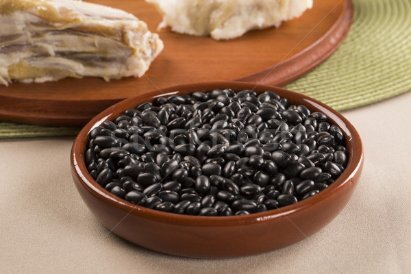Black beans on wooden background Stock photo © paulovilela