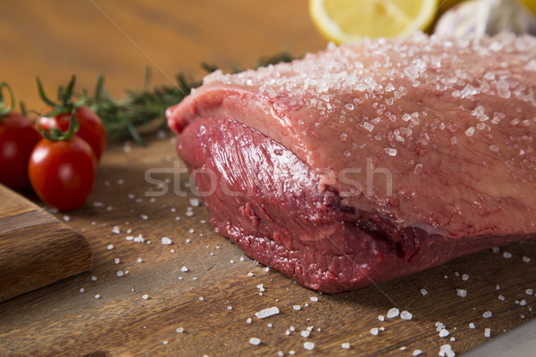 Nyers steak fa deszka paradicsom vacsora piros Stock fotó © paulovilela