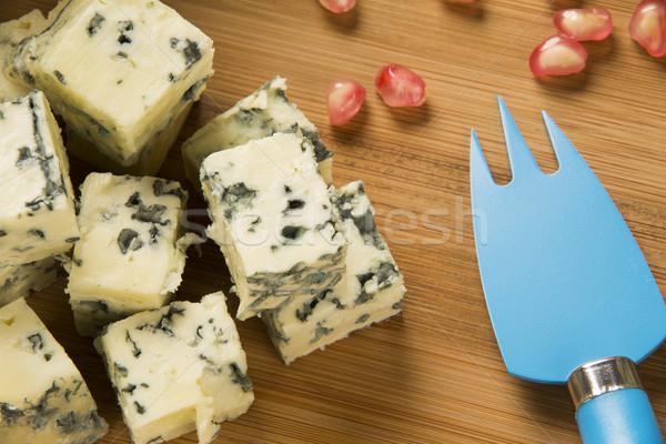 Formaggio tipo gorgonzola legno alimentare sfondo blu Foto d'archivio © paulovilela
