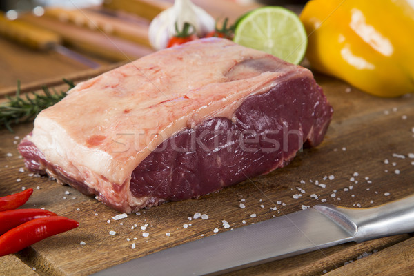 Organic Red Raw Steak Sirloin on wooden board Stock photo © paulovilela
