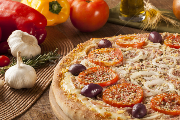 Hagyományos olasz pizza fából készült hozzávalók sajt Stock fotó © paulovilela