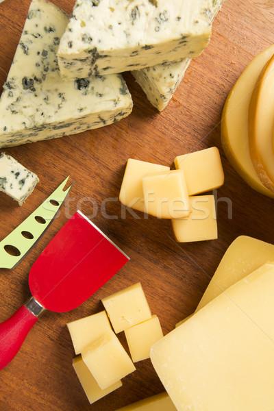 Különböző vágódeszka finom étel háttér kék Stock fotó © paulovilela